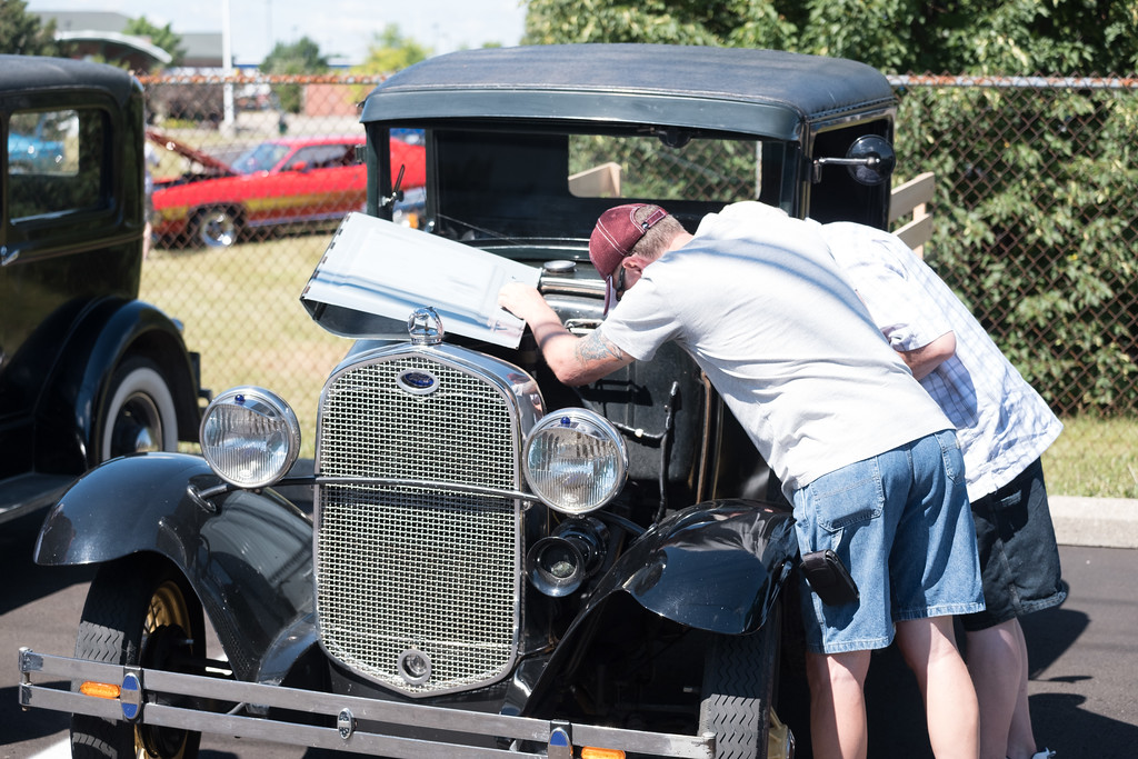 . Checking under the hood, a popular site along Fort Street during the Cruise. Despite several cities urging cruisers to stay home, the 18th Annual Cruisin\' Downriver kicked off Saturday morning. Photos by Matt Thompson for The News-Herald