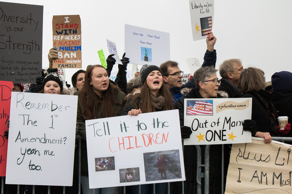 . Samantha Moryocco, Maisyn McKinney and Alex Grauer of Imlay City, MI protest along side Julie Devine of Farmington Hills, MI. Photo by Debbie Malyn for the News Herald and Digital First Media.