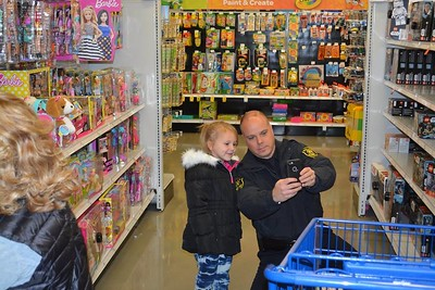 Members of the Huron Township Police and Fire Departments, Santa and several children from within the community went on the annual shop with a hero event recently. Photo courtesy Huron Township Public Safety Department