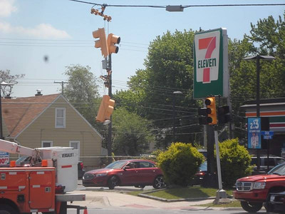 "Motorists should avoid the area of Dix-Toledo and Cicotte in Lincoln Park as crews work to repair a smashed stop light. The light was struck by the top of an oversized load that was being hauled on a flatbed trailer through the intersection at about 1:15 p.m. Thursday. Local resident Al Poe, who saw the light as it was ""taken out"" by the load on the trailer said repair crews were on site within minutes. As of 2:30 p.m. repair crews were still installing a replacement light at the intersection. Photos courtesy of Al Poe"
