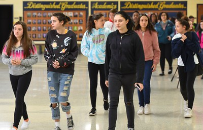 Hundreds of Roosevelt High School students walked out of school and onto the football field, where they paused for a moment of silence and walked around the track for 17 minutes to honor the 17 victims of the Feb. 14 school shooting in Parkland, Florida. Alex Franzen – For The News-Herald