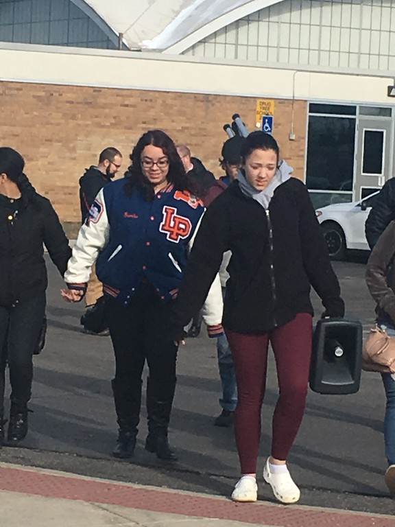 . Lincoln Park High School students walked out onto the football field where they held signs saying LPHS IS PARKLAND STRONG. Dave Herndon � The News-Herald