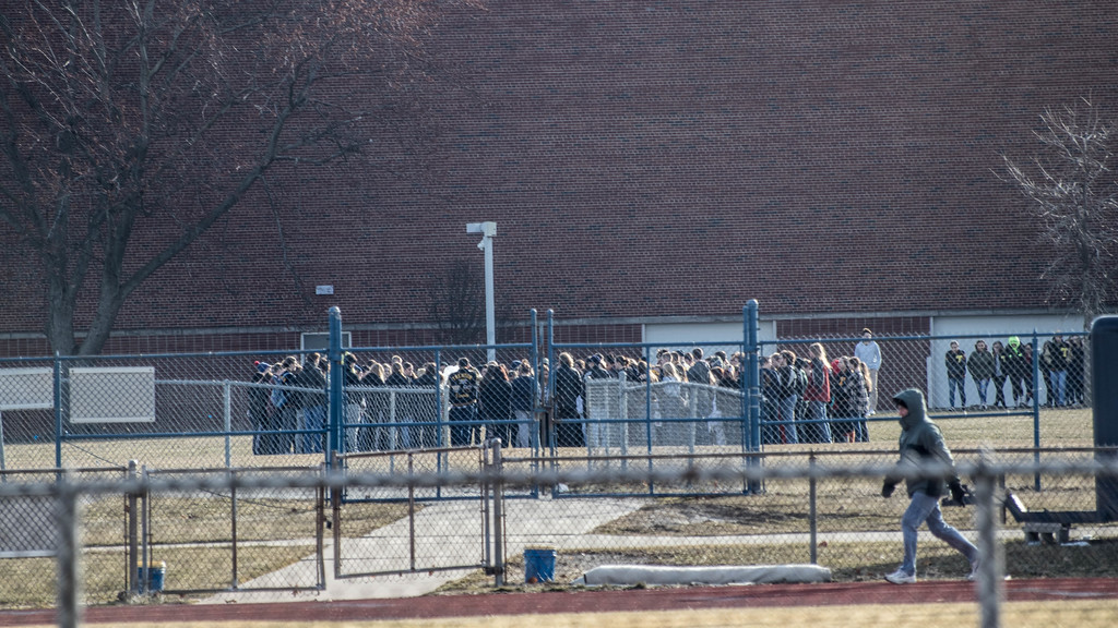 . Students at Trenton High School gathered near the football field and railled against gun violence. School officials forbade the media from being on school property to cover the event. Kirsten Nordstrom � For The News-Herald