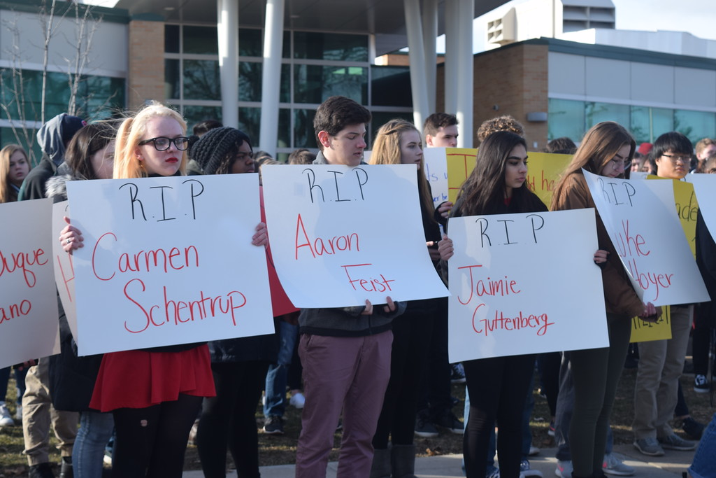 . While some Allen Park High School students gathered on the football field, others protested in front of the school, holding signs with the names of the 17 people who died in the Feb. 14 shooting in Parkland, Florida. The students also called for an end to school shootings. Jim Kasuba � The News-Herald