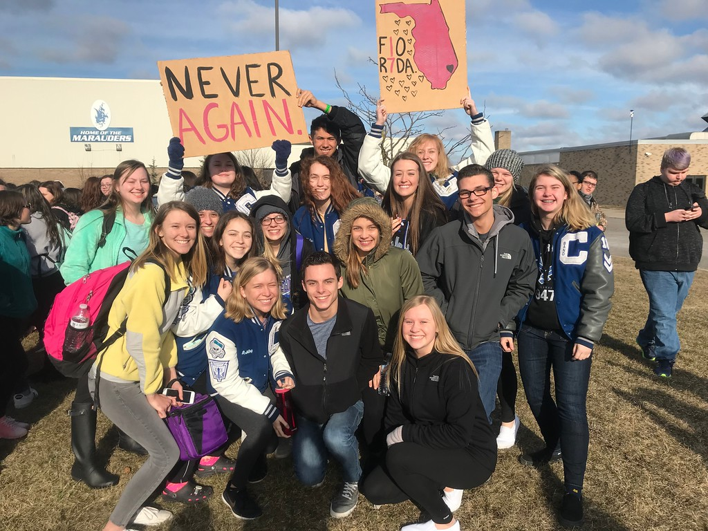 . Julie Hughes, a senior at Carlson High School, gave a speech to her classmates who joined in Wednesday\'s protests outside of the school. She said she wanted to create a safe place for all of her fellow students to share their thoughts on the issue of school violence. Photo courtesy of Julie Hughes