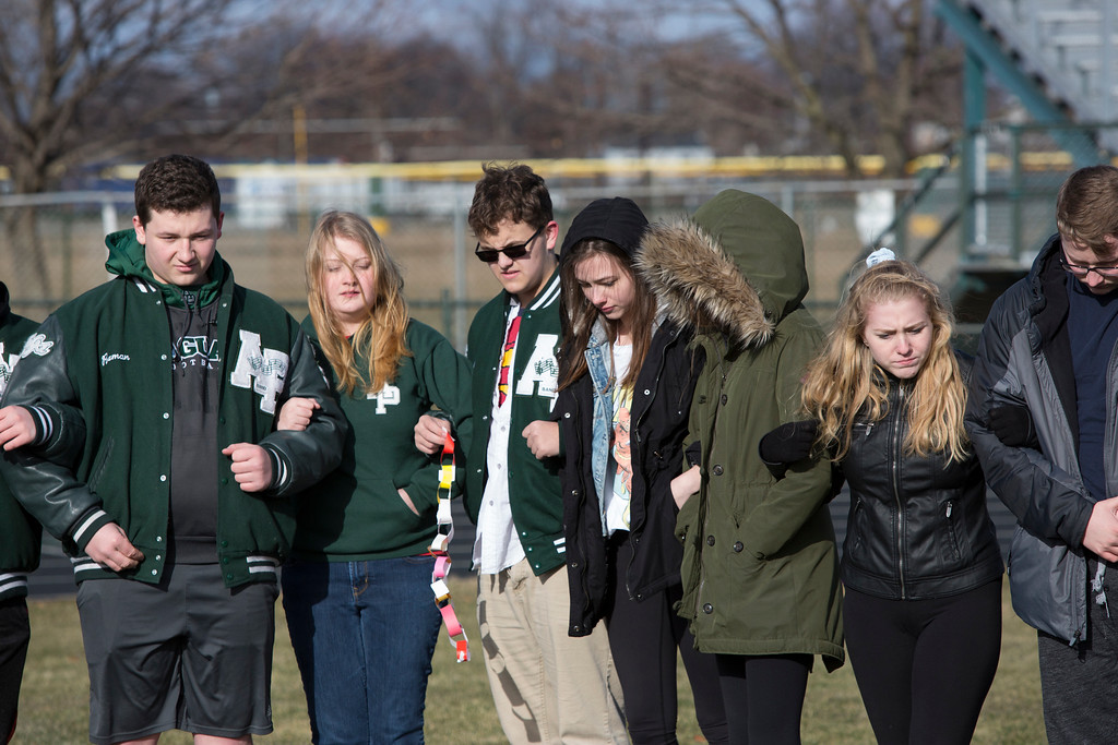 . Students at Allen Park High School locked arms on the football field in remembrance of victims of school violence around the country. Michelle Fish � For The News-Herald