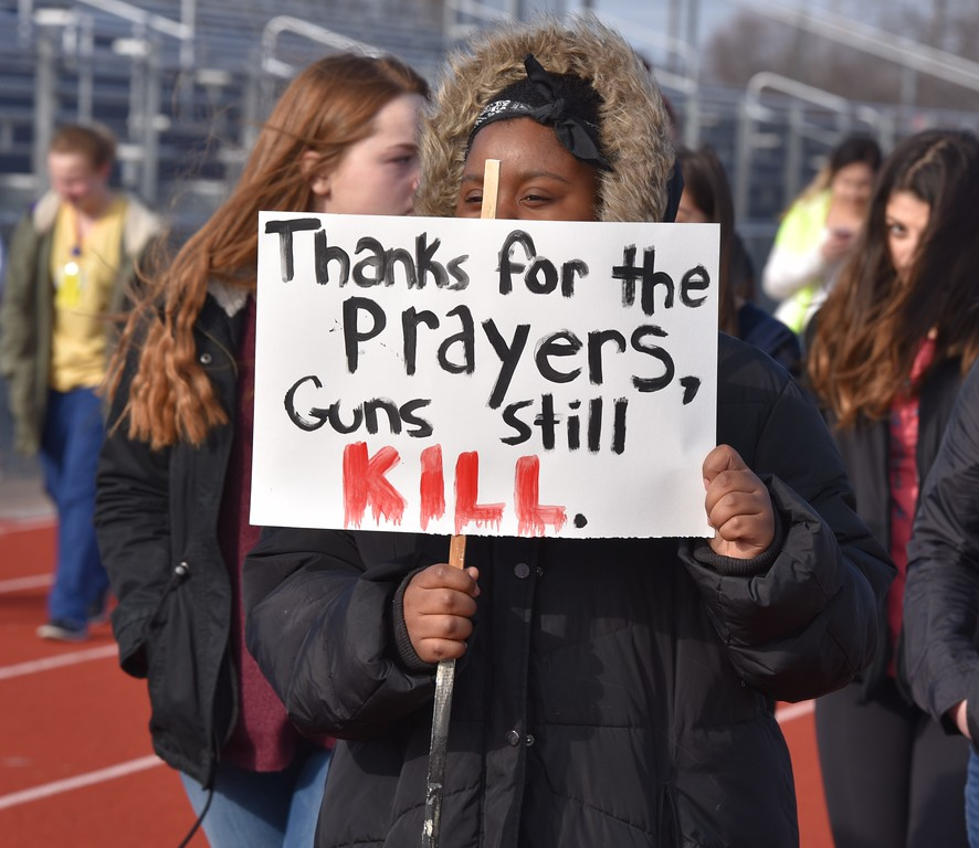 . Hundreds of Roosevelt High School students walked out of school and onto the football field, where they paused for a moment of silence and walked around the track for 17 minutes to honor the 17 victims of the Feb. 14 school shooting in Parkland, Florida. Alex Franzen � For The News-Herald