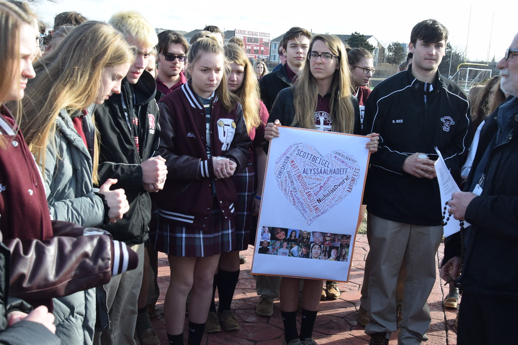 . Students at Gabriel Richard Catholic High School in Riverview held a prayer service inside the school. The entire school then walked out to the football field and prayed together for the victims of the Feb. 12 shooting at Marjory Stoneman Douglas High School in Parkland, Florida, as well as all other past school shootings. Photo courtesy Anna Lisa Fedor
