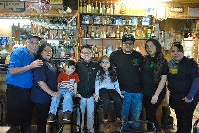 Jose Longoria (left), owner of Pancho's Mexican Restaurant in Lincoln Park, stands with his wife, Leticia; grandchildren, Gabe Nunez, Carlos Nunez and Jasmin Nunez; son, Jose; daughter, Laura; and niece, Vicky. Robert Kobylasz – For The News-Herald