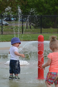 Ryan Gorgon, was the first person to tempt the waters at the new Jeffrey P. Lamarand Splash pad Thursday night. Photo courtesy of Dave Gorgon