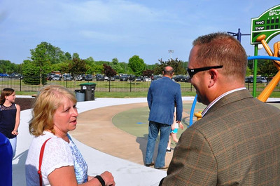 Mishelle Lamarand, widow of the former mayor, and her two children were on hand for the ribbon cutting to open the new Splash Pad in Heritage Park. The new water attraction was named in honor of her husband. Photo courtesy City of Taylor