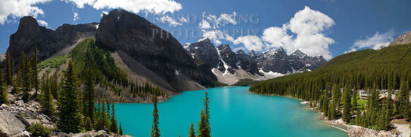 "Moraine Lake - The Iconic Shot <br /> (taken from the Rock Pile)<br /> <br /> This particular image is a 30-image blend - two 15-shot panoramics shot at different exposures, manually blended together.  Although the insane color of the lake might make you think otherwise, the lake really is this blue - in fact in my search of pictures of Moraine Lake on the web, I have not been able to find an image that captures the scale, color, and beauty of this amazing place better than this image.<br /> <br /> I have this image available for purchase printed on a stunning 55x17"" fine art gallery wrapped canvas (other sizes available but due to the incredible resolution of 30 combined images, it is best viewed BIG!) Purchase this on canvas at <a href=""http://www.EpicWallArt.com"">http://www.EpicWallArt.com</a>"