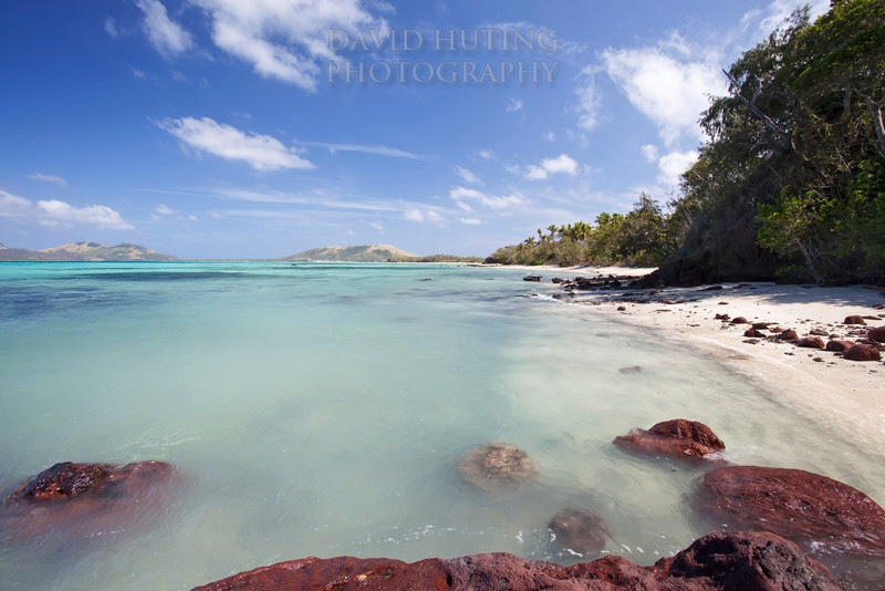 Colorful Red Rock Beach View