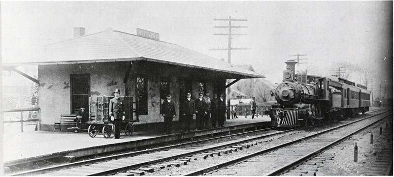 """A train pulls into the new passenger station at Monroe Street, Auburn, NY in 1908. The train is  pulled by Engine Number 1. Central's """"Auburn Branch"""" tracks are to right of the train. (Photo ID: 38286 b)"""