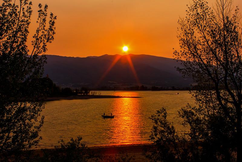 The sun setting over Pineview Reservoir near Huntsville