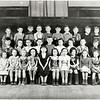 Genoa school students, year unknown. First row: ?, ?, Jean Lamphier, Nancy Rogers, Rhoda Whitten, Sharon Quinn, Sharon Parmley, Mary Milliman, Miriam Rewald, ?, ?, Joan Saxton, ?, ?.  Second row: ?, ?, William Reeves, ?, ?, Shirley DeLap, ?, Gunn Ronald Swartwood, Ann Grobenly, Patricia Thompson, Mick Reeves, ?, ?, ?, ?.  Third row: ?, ?, ?, ?, Raymond Kellogg, Douglas Purinton, Gerald Mastin, ?, ?, Ronald Marshall, John Pusloski, Bobby Olson, David Armstong. (Photo ID: 45239)