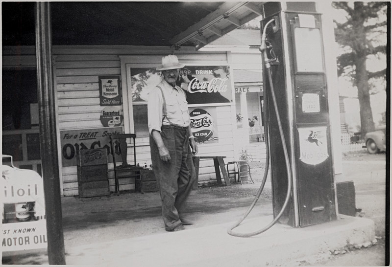 Gas Station located on the North corner of Rt. 90 and Rt. 34 in Genoa in front of the Tamarack.  It was owned by Lyman Gulick, pictured. (Photo ID: 36554)