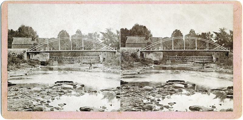 Road bridge at Forks of Creek. The blacksmith shop is behind the bridge. (Photo ID: 29672)