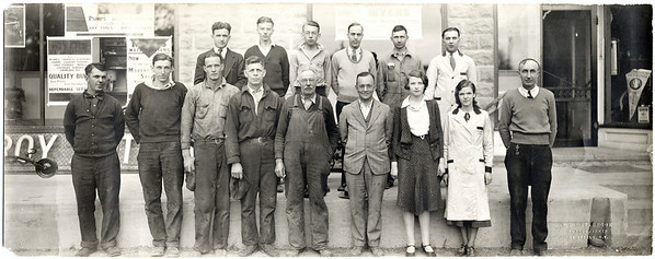 Roy Tuttle Employees.  Back row: Fred Tuttle, Gordon Palmer, Gordon Fritts, Clarence Shaw, George Spraker and James Cummings.  Front row: Ed Dinkle, Sr., Francis Mahaney, Floyd Hall, Dennis Doyle, Horace Counsell, Roy Tuttle, Leotta Rowland Conner, Eleanor Brill Keim and Bryon Fritts. (Photo ID: 27915)