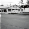 Ray Boles Auction House, October 1985. Formerly Gilling & Nedrow IH Machinery. This building has been a bake shop many times, antique shop, luncheon, and Dinasur Dry Goods. Northeast corner of 34B an RT 90, King Ferry, NY. (Photo ID: 35144)