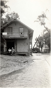 Kings Ferry train station with two men during a flood. (Photo ID: 28587)