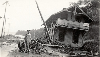 Kings Ferry train station after the flooding of Cayuga Lake in 1935. Dayton Atwater pictured. (Photo ID: 28607)