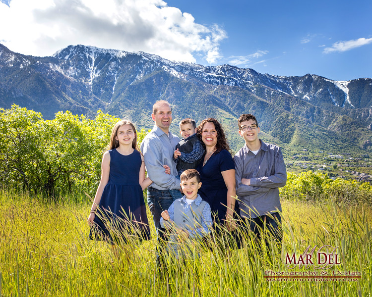 family with mountains