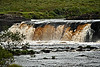 Aasleagh Waterfall on the River Erriff.<br /> Apparently the water is always this amber color, achieved as the river receives run-off from peaty soil that is rich in tannic acid..<br /> <br /> County Mayo, Ireland.