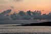 Sun rising over Isla Espanola or Hood Island.<br /> <br /> 5:56 a.m. GDST<br /> Isla Espanola, Galapagos Islands, Ecuador.<br /> May 21, 2009