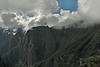 "Machu Picchu #06<br /> <br /> We were treated to a ""light show"" over the region surrounding the archaeological site as clouds streamed across neighboring peaks and drifted down into valleys."