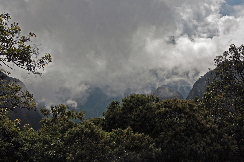 Machu Picchu #01<br /> Clouds in the neighboring valleys as we approach the entrance.