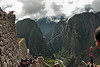 Machu Picchu #07<br /> <br /> Heading down the first main flight of stairs after crossing the terraces from the tourist entrance.<br /> <br /> It would be impossible to convey a real sense of this place without including views of its surroundings.  The Incas who chose this site chose to live amidst incredible natural beauty.