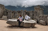 """Machu Picchu #136.<br /> <br /> In the Sacred Plaza there is a large stone thought to be """"in transit"""".  Evidence of rock """"rollers"""" used by Incas to move such blocks can still be seen beneath it.  It was probably destined to be the central support pillar for the front of the Principal Temple."""
