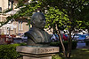 Zadar, Croatia (Old Town)<br /> A bust of some 19th c. famous Croatian.  Look carefully in the left background.  You'll see, painted white, a wellhead frame and pulley virtually identical to the ones at Trg 5 Bunara that date to the 16th c.  The street in the background is Trg Tri Bunara (Square of Three Wells).
