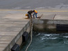 Hauling in a second mooring line for the stern.<br /> <br /> Rethymnon, Crete<br /> 2011