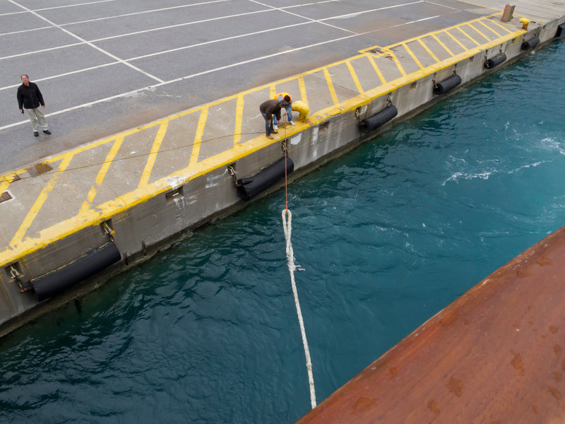MS G13 01<br /> Drawing across the mooring line with the heaving line.<br /> Preparing to dock at Rethymnon (or Rethymnon), our port of call for day trips the Chania or Knossos and Heraklion Crete.<br /> We were the first cruise ship of the season to dock at Rethymno, and as such we were welcomed by the town mayor, who brought fragrant bouquets of herbs and flowers for each cabin.