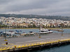 A marina, and the town beyond.<br /> <br /> Rethymnon, Crete<br /> 2011<br /> (The mouth of this small marina is map tagged.)