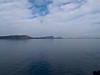 The long island of Sfaktiria, that nearly completely encloses the bay at Pylos, and gives it one of the best protected harbors in the Greek Peloponnese.<br /> Seen from aboard the ship.<br /> 2011.