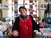 MS G16 15<br /> The charming shop clerk (owner?) who helped me find just the right map and book to help me remember my visit.  <br /> (Since I took this picture so hurriedly that it is badly out of focus, I decided to apply some judicious pp to it.)<br /> <br /> Seen during my afternoon walk in the area of the harbor and town square.<br /> Pylos, Messenia, Greece.<br /> 2011.