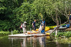 D213-2014  Gallup Canoe Livery staff delivering boats and paddlers to the dock at Barton Park for a down river paddle/float trip back to Gallup Park.  The dock is a little way down river from the Barton Dam.<br /> <br /> Barton Park on the Huron River, Ann Arbor, Michigan<br /> August 1, 2014