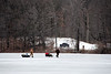 Ice fishermen moving their location.<br /> <br /> March 16, 2008<br /> Crooked Lake, Michigan