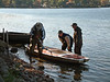 Pumping out the hull with a handmade pump, lightening the load before lifting the sailboat out of the water.<br /> <br /> October 29, 2004