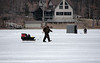 Ice fisherman moving yet again.<br /> <br /> March 16, 2008<br /> Crooked Lake, Michigan