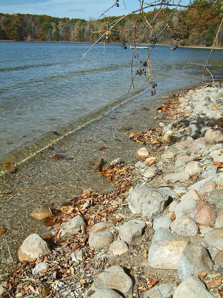 In 2003 the water was still low enough that there was a narrow strip of beach, and the rocks that buttress the breakwater were above the lake level.