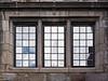 Close up of windows above quotation, Detail, Law Quad, northeast corner