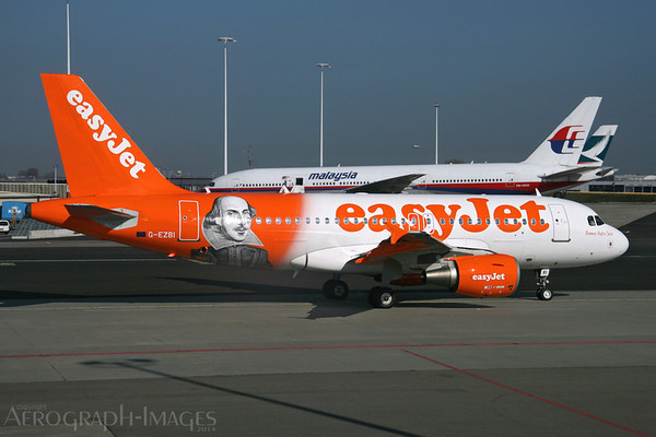 Reg:  G-EZBIOperator:  easyJet AirlineType:  Airbus A.319-111  C/n:  3003Location:  Amsterdam - Schiphol (AMS / EHAM), The NetherlandseasyJet's latest logojet Romeo Alpha Juliet featuring the portrait of William Shakespeare on the rear fuselage. Photo Date:  25 March 2014Photo ID:  1400961