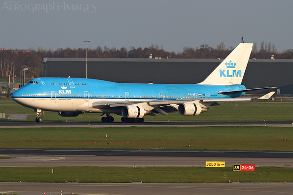 "Reg:  PH-BFD (FD-026)Operator:  KLM Royal Dutch AirlinesType:  Boeing 747-406(SCD)  C/n:  24001 / 737Location:  Amsterdam - Schiphol (AMS / EHAM), The NetherlandsKLM's ""Dubai"" rolling out on runway 36R in late afternoon sunshine, arriving from Shanghai as ""KLM896"".  Photo Date:  25 March 2014Photo ID:  1400965"