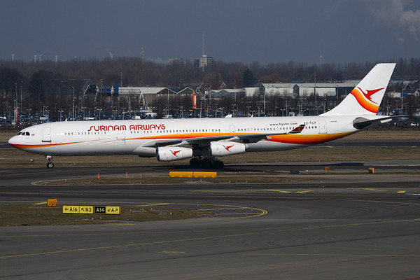 Reg: PZ-TCP Operator: Surinam Airways Type:  Airbus A.340-311		   C/n: 49   The daily Surinam Airways flight arrives at Amsterdam-Schiphol, photographed from the excellent panorama deck above the terminals.     Photo Date: 09 March 2010 Photo ID: 1200472