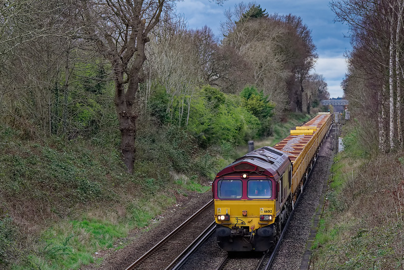 66012 approaches Guildford with 6N02, the 12:57 Eastleigh East Yard - Shalford Junction, departmental service, on 14th March 2020. The service had run round in Woking up Yard.