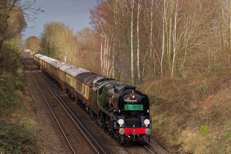 """35028 """"Clan Line"""" top & tailed with 67024 drifts down towards Guildford with 1Y82, the <br /> 12:21 Victoria - Shalford """"British Pullman"""" on 14th December 2019."""